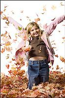 pile leaves playing - Young girl playing in fallen leaves Stock Photo - Premium Royalty-Freenull, Code: 640-02770476