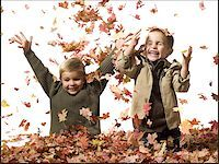 pile leaves playing - Young children playing in pile of fallen leaves Stock Photo - Premium Royalty-Freenull, Code: 640-02770478