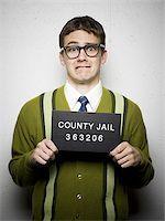 Mug shot of nerd with glasses Stock Photo - Premium Royalty-Freenull, Code: 640-02770774