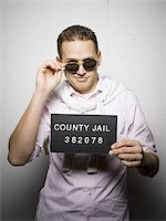 Mug shot of stylish man with sunglasses Stock Photo - Premium Royalty-Freenull, Code: 640-02770776
