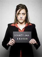 Mug shot of woman in business attire Stock Photo - Premium Royalty-Freenull, Code: 640-02770785