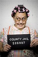 Mug shot of housewife with curlers Stock Photo - Premium Royalty-Freenull, Code: 640-02770789