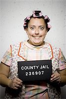 Mug shot of housewife with curlers Stock Photo - Premium Royalty-Freenull, Code: 640-02770791