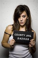 Mug shot of disheveled woman Stock Photo - Premium Royalty-Freenull, Code: 640-02770793