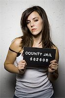 Mug shot of disheveled woman Stock Photo - Premium Royalty-Freenull, Code: 640-02770794