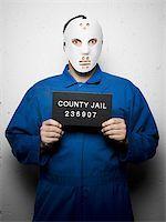 Mug shot of man with hockey mask Stock Photo - Premium Royalty-Freenull, Code: 640-02770795