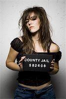 Mug shot of woman with messy hair Stock Photo - Premium Royalty-Freenull, Code: 640-02770796