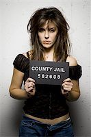 Mug shot of woman with messy hair Stock Photo - Premium Royalty-Freenull, Code: 640-02770797