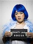 Mug shot of man in drag with blue wig and feather boa Stock Photo - Premium Royalty-Free, Artist: AWL Images, Code: 640-02770804