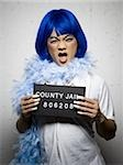 Mug shot of man in drag with blue wig and feather boa Stock Photo - Premium Royalty-Free, Artist: AWL Images, Code: 640-02770807