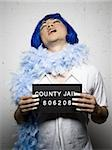 Mug shot of man in drag with blue wig and feather boa Stock Photo - Premium Royalty-Free, Artist: AWL Images, Code: 640-02770808