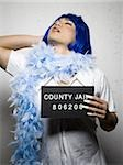 Mug shot of man in drag with blue wig and feather boa Stock Photo - Premium Royalty-Free, Artist: Robert Harding Images, Code: 640-02770809