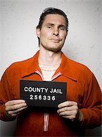 Mug shot of casually dressed man with gold chains Stock Photo - Premium Royalty-Freenull, Code: 640-02770816