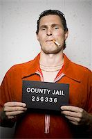 Mug shot of casually dressed man with gold chains Stock Photo - Premium Royalty-Freenull, Code: 640-02770818