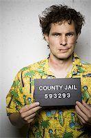 Mug shot of man in Hawaiian shirt with cuts and scrapes Stock Photo - Premium Royalty-Freenull, Code: 640-02770821