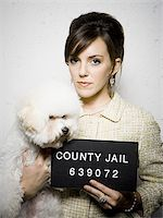 Mug shot of formally dressed woman with dog Stock Photo - Premium Royalty-Freenull, Code: 640-02771004