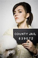 Mug shot of formally dressed woman with dog Stock Photo - Premium Royalty-Freenull, Code: 640-02771005