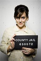 Mug shot of formally dressed woman Stock Photo - Premium Royalty-Freenull, Code: 640-02771006