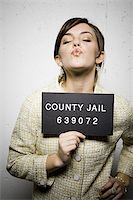 Mug shot of formally dressed woman Stock Photo - Premium Royalty-Freenull, Code: 640-02771008