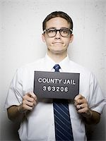 Mug shot of nerd with glasses Stock Photo - Premium Royalty-Freenull, Code: 640-02771022