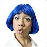 Man with blue wig and makeup yelling Stock Photo - Premium Royalty-Free, Artist: Robert Harding Images, Code: 640-02771355