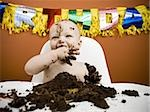 Baby eating birthday cake Stock Photo - Premium Royalty-Free, Artist: Siephoto, Code: 640-02772603