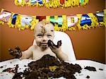 Baby eating birthday cake Stock Photo - Premium Royalty-Free, Artist: Jerzyworks, Code: 640-02772604