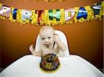 Baby eating birthday cake Stock Photo - Premium Royalty-Free, Artist: Siephoto, Code: 640-02772605