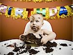 Baby eating birthday cake Stock Photo - Premium Royalty-Free, Artist: Push Pictures, Code: 640-02772607