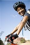 Female cyclist with helmet outdoors smiling Stock Photo - Premium Royalty-Free, Artist: Pierre Arsenault, Code: 640-02773179