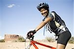 Female cyclist with helmet outdoors smiling Stock Photo - Premium Royalty-Free, Artist: Rommel, Code: 640-02773184