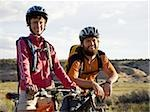 Man and woman with bicycles and helmets outdoors smiling Stock Photo - Premium Royalty-Free, Artist: Anne Domdey, Code: 640-02773206