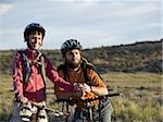 Man and woman with bicycles and helmets outdoors smiling Stock Photo - Premium Royalty-Free, Artist: Rommel, Code: 640-02773207
