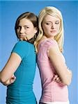 Two girls with arms crossed back to back scowling Stock Photo - Premium Royalty-Free, Artist: Kathleen Finlay          , Code: 640-02773491