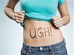 Female Abdomen with UGH! written on it Stock Photo - Premium Royalty-Free, Artist: Jerzyworks, Code: 640-02773724