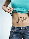 Female Abdomen with UGH! written on it Stock Photo - Premium Royalty-Free, Artist: urbanlip.com, Code: 640-02773727