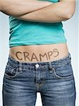 Female Abdomen with CRAMPS written on it Stock Photo - Premium Royalty-Free, Artist: Masterfile, Code: 640-02773732