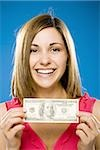 Woman holding one hundred American dollar bill smiling Stock Photo - Premium Royalty-Free, Artist: AWL Images, Code: 640-02773968