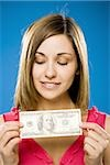 Woman holding American hundred dollar bill Stock Photo - Premium Royalty-Free, Artist: AWL Images, Code: 640-02773969