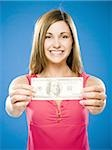 Woman holding American hundred dollar bill Stock Photo - Premium Royalty-Free, Artist: AWL Images, Code: 640-02773971