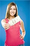 Woman holding American hundred dollar bill Stock Photo - Premium Royalty-Free, Artist: Ikon Images, Code: 640-02773972
