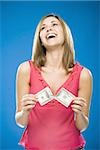 Woman tearing American hundred dollar bill smiling Stock Photo - Premium Royalty-Free, Artist: AWL Images, Code: 640-02773981