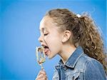 Profile of girl licking batter off beater Stock Photo - Premium Royalty-Free, Artist: Apolonia, Code: 640-02774402