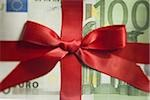 One hundred Euro banknote with red ribbon closeup Stock Photo - Premium Royalty-Free, Artist: Westend61, Code: 640-02774592
