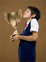 preteen kissing - Boy kissing trophy cup Stock Photo - Premium Royalty-Freenull, Code: 640-02774601