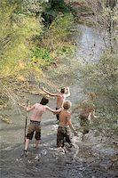 pre-teen boy models - four boys crossing a river. Stock Photo - Premium Royalty-Freenull, Code: 640-02777469