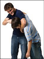 two brothers wrestling. Stock Photo - Premium Royalty-Freenull, Code: 640-02777510
