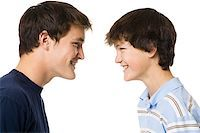 older boy and younger boy head to head. Stock Photo - Premium Royalty-Freenull, Code: 640-02777523