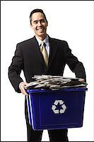 businessperson holding a recycling bin Stock Photo - Premium Royalty-Freenull, Code: 640-02778408