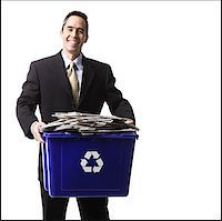 businessperson holding a recycling bin Stock Photo - Premium Royalty-Freenull, Code: 640-02778409